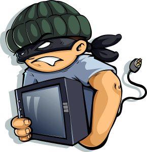 Burglar stealing a monitor